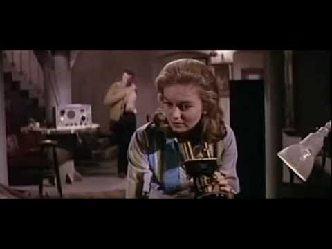 "The science fiction film ""The Day of the Triffids"" (1962), directed by Steve Sekely and starring Howard Keel and Janette Scott. Based upon the classic novel by John Wyndham. The finished film was deemed too short, so an uncredited Freddie Francis was brought in to direct the climactic lighthouse sequence between 1:27:29 and 1:33:31."