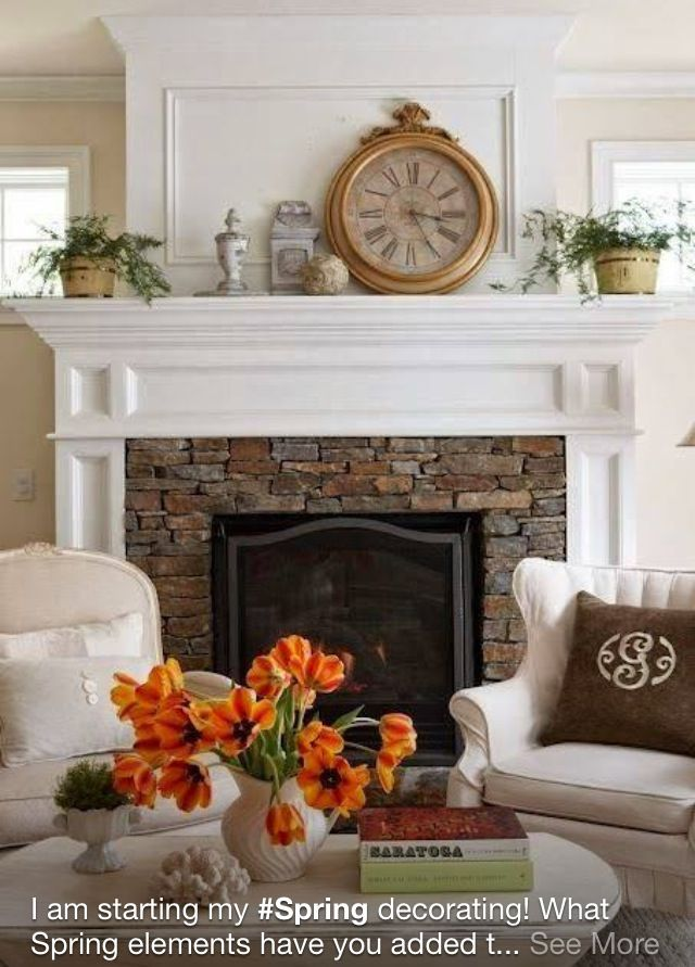 love the stacked stone fireplace mantel and windows