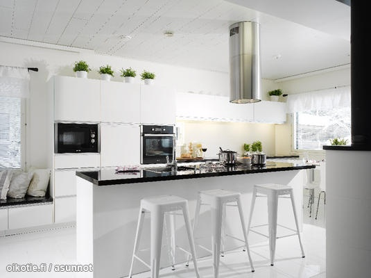 White kitchen with Tolix chairs