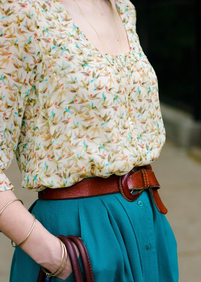 Bird pattern colorful blouse, leather belt, teal skirt and gold accent jewelry
