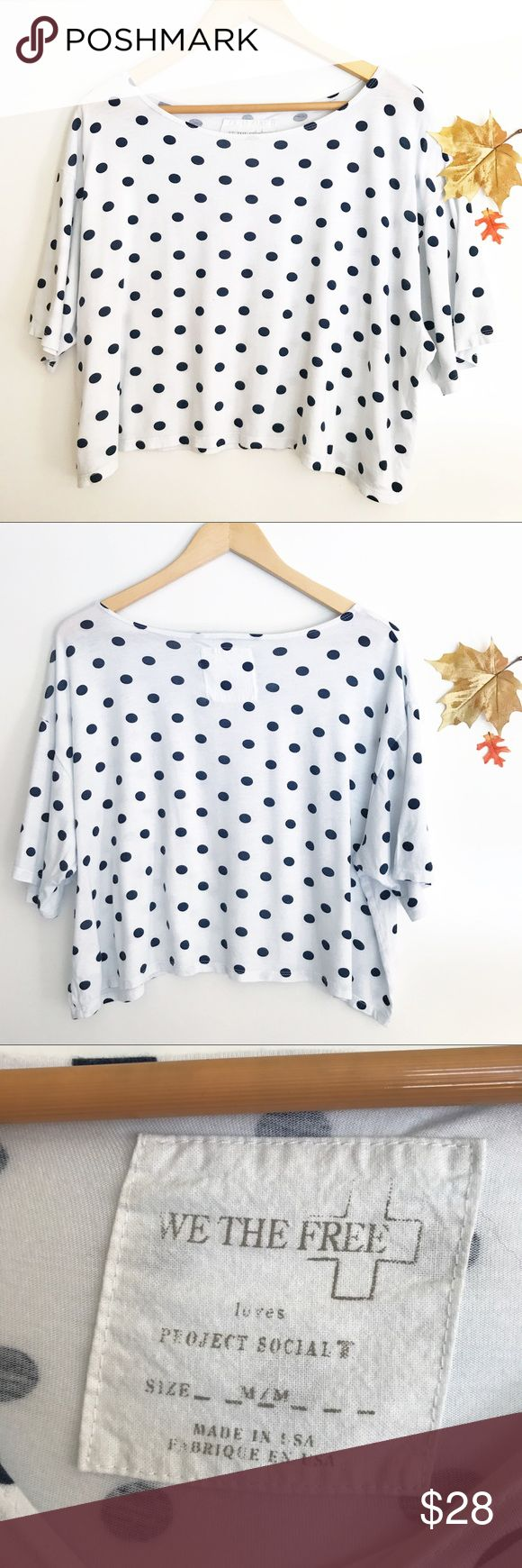 "Free People We White Navy Polka Dot Tshirt Medium Free People (We The Free) oversized boxy Tshirt, white with navy blue polka dots. Gently pre-owned, no flaws. Size Medium. Underarm to underarm: 25"" Length, shoulder to hem: 18"" (Inventory I18) Free People Tops Tees - Short Sleeve"