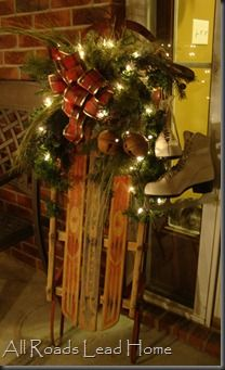 <3 old sled, sleigh bells, lit greenery & skates!!! (look closely for the dog peeking out!)