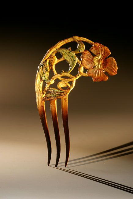Unsigned French Art Nouveau comb, painted horn. circa 1900. Via The Creative Museum.