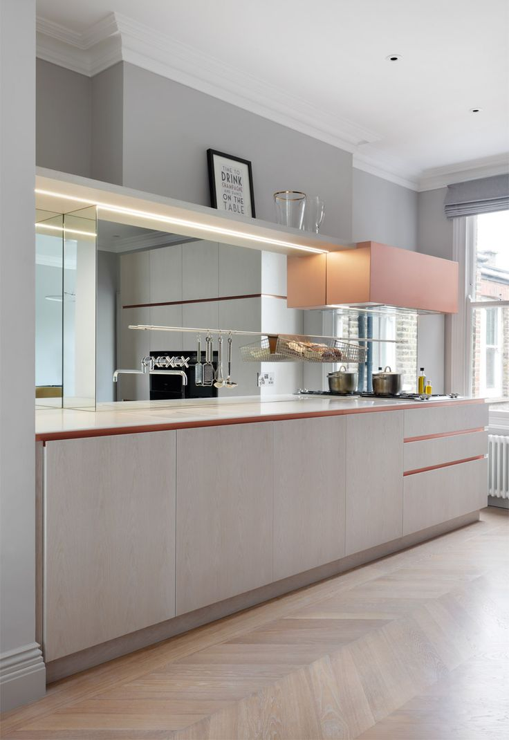 Copper fixtures and marble surfaces added to Victorian apartment in London