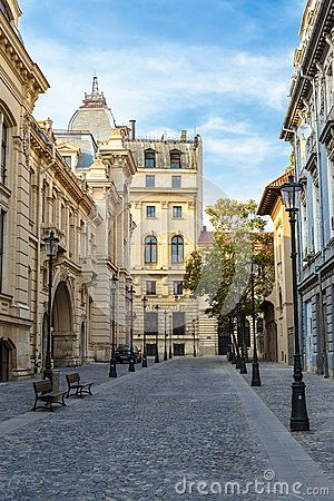 City view with historical buildings and cobblestone street in the old historical center Lipscani, Bucharest, Romania.