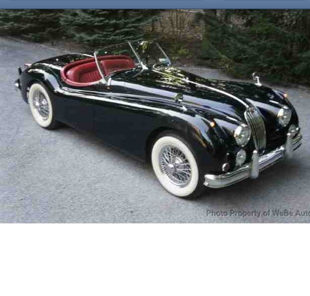 My dream car of all time!1956 Jaguar Roadster- red interior but with right side driving