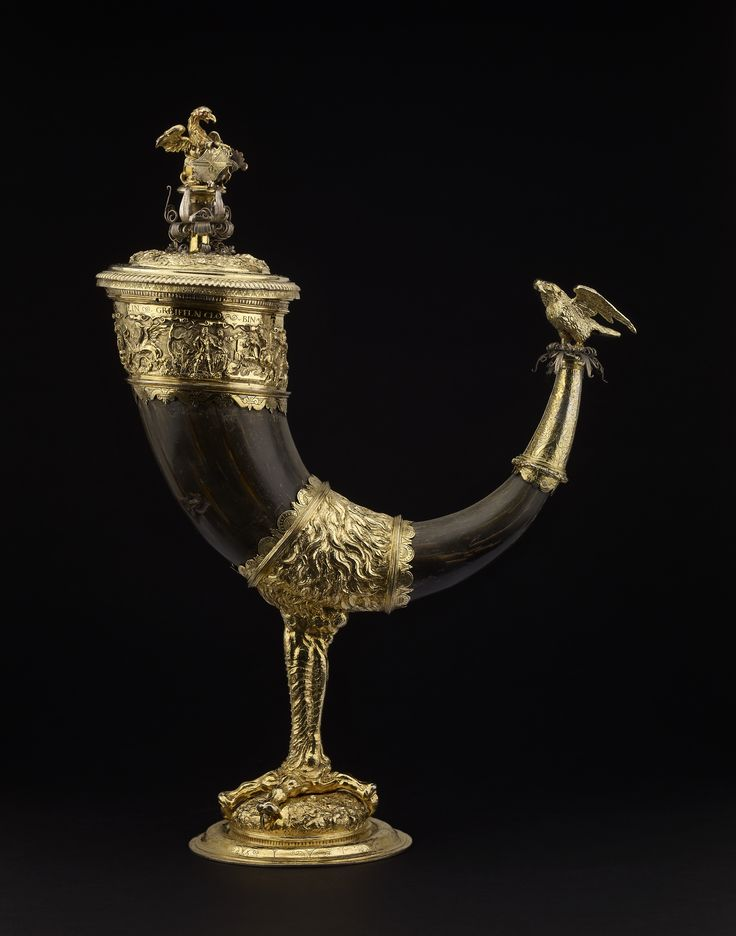 Mainz,  mid 16th century. Supposedly a claw of the mythical griffin, half- eagle, half-lion, who speaks in German on the lip: 'A griffin's claw I am called, in Asia, Arabia I am well known'. The cup is made from a buffalo horn, set on a claw to resemble the griffin's talon. This one was made for the von Greiffenclau family who took their name and arms from the griffin.