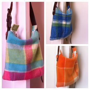 Vintage wool blankets and old men's belts upcycled into great handbags. I want one!!!