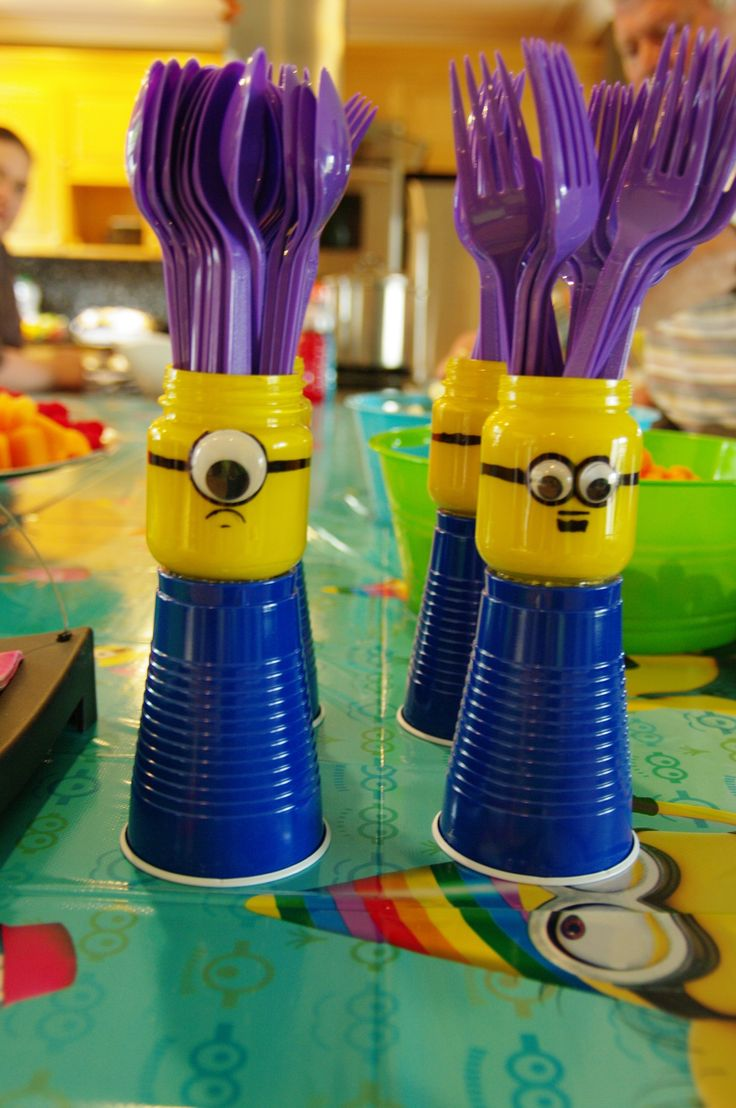 Minion cutlery holders.  Repurposed leftover Lego mini figure heads into Minions. Spray painted the inside of baby food jars (keep twirling paint around as it dries or it will be drippy if over sprayed- let dry very well before use, otherwise cutlery, straws may stick in wet paint- lesson learned ;-(  stick on google eyes & sharpie goggles & mouth - super cute!