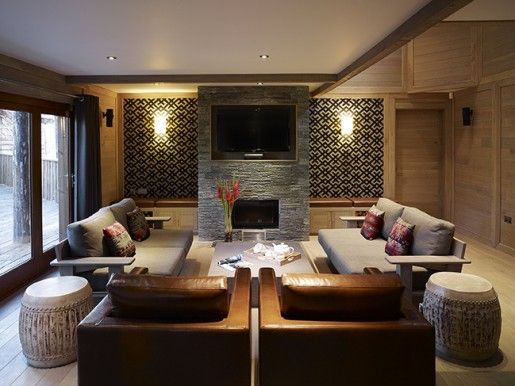 "The open-plan living area features a 42"" plasma TV mounted above the fireplace and iPod docks throughout. (Pictured: Sherwood Forest Treehouse)"
