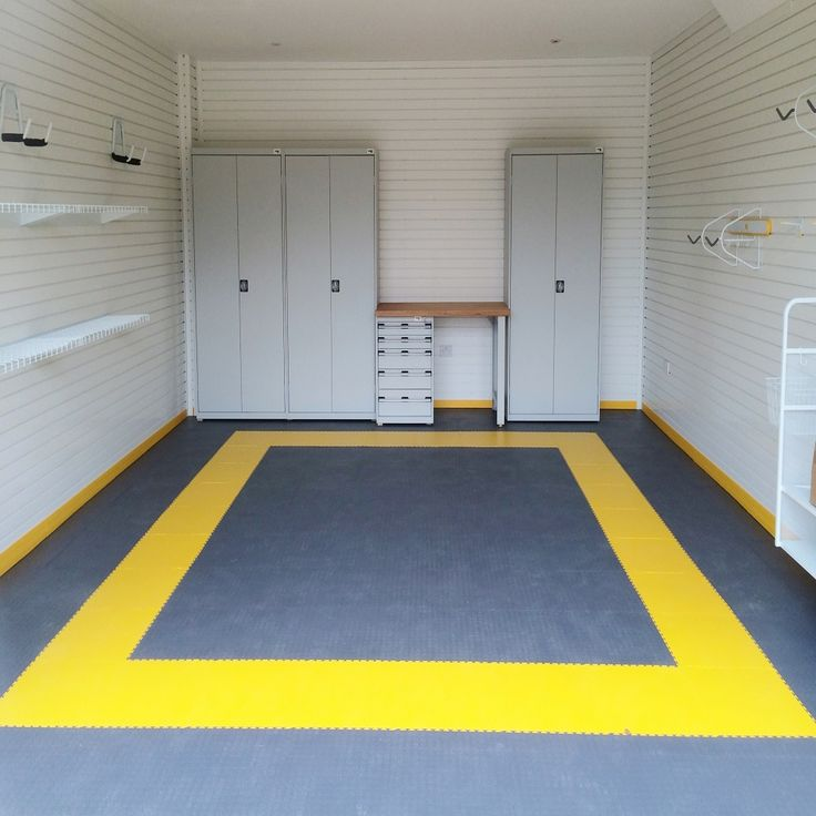 This owner wanted to draw a border around his garage to create a parking bay.  You can do this and much more with our garage floor tiles.