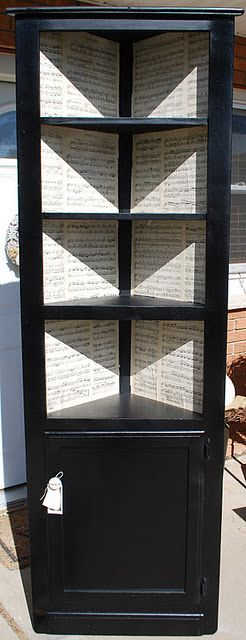 corner cabinet redo-love the sheet music inside.
