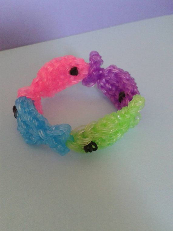 Hey, I found this really awesome Etsy listing at https://www.etsy.com/listing/205637158/rainbow-loom-glowing-fish-armband