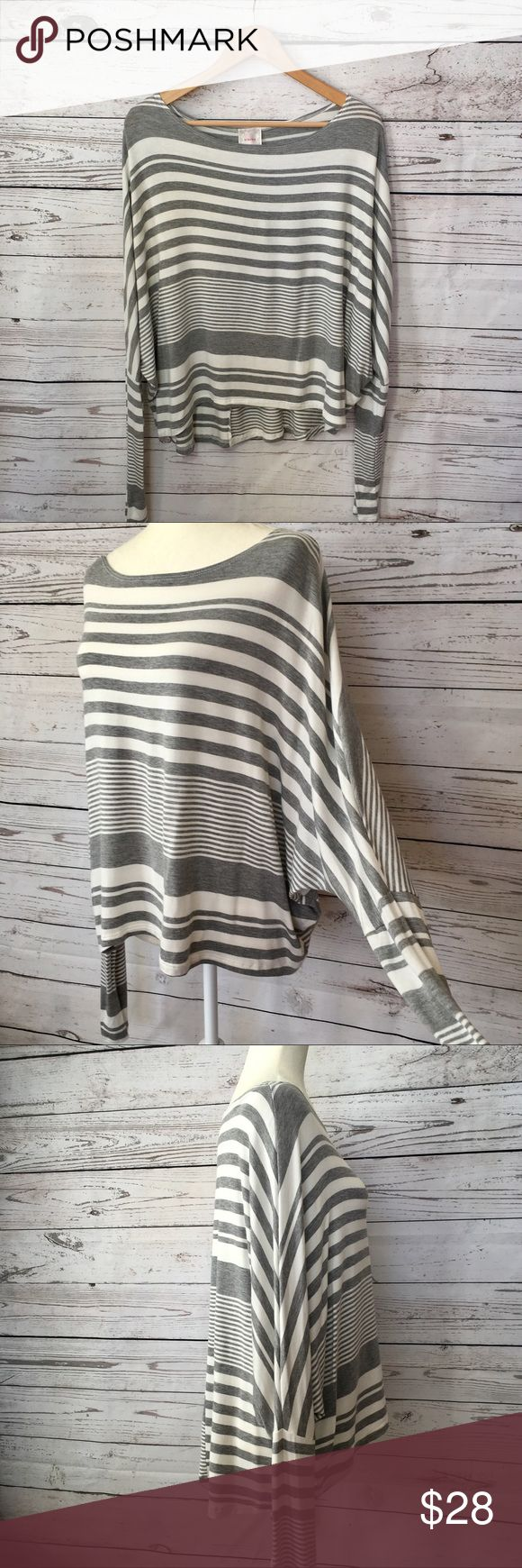 NEW Striped gray and white Dolman sleeve hi lo top •Details• Draping loose fit long dolman / batwing sleeve  striped top.  High low hem •Condition• New without tags •Material•95% rayon 5% spandex t-shirt type material •Color• Gray and white All measurements taken while item is laying flat & are approximate •Armpit to Armpit•  •Length•.                                        •Sleeve length• NYMPHE Tops