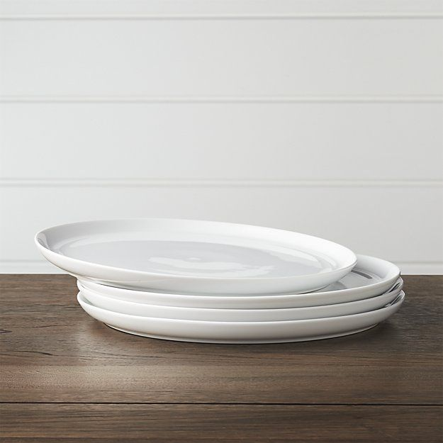 Set of 4 Hue White Dinner Plates. (We didn't register for china, so we picked simple dishes that can be dressed up with linens, etc. We got 14 place settings so we have enough for parties.)