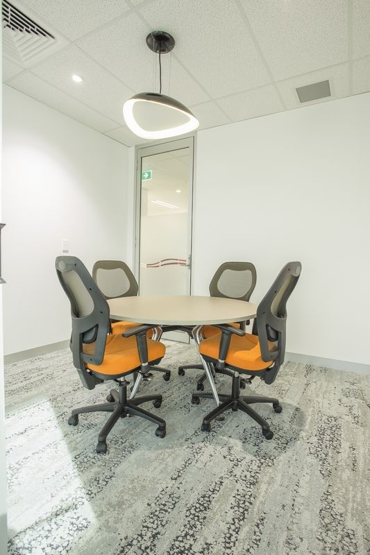 BURGMATIC MESH chairs & LUNA meeting table by Burgtec (Williams Electrical office fit-out)