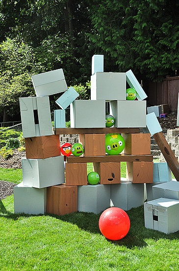 Angry birds fun outdoor game. Love the use of empty cardboard boxes.