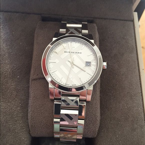 Woman's Burberry watch Worn only a few times, not one scratch. Comes with all links. Stainless steel, Burberry print around band. Burberry Jewelry