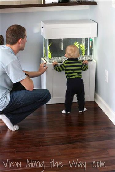 Toddler-sized aquarium. What a great idea! Kids are so curious, and this helps them learn about fish (and pets), but might deter them from climbing on high furniture to get a good view of the a bigger fish tank higher off the ground in the living room, etc.