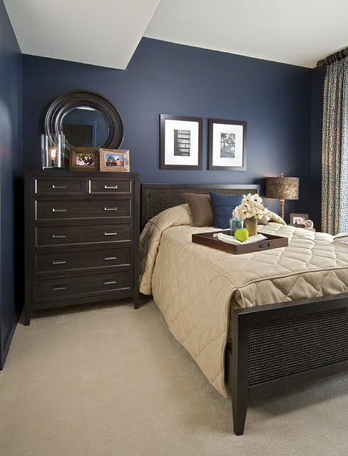 Sample navy blue and brown bedroom in an EYA townhome in