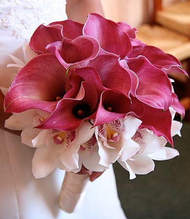 Bridal Floral Arrangement Designed Using Magenta Calla Lily White Cymbidium Orchids