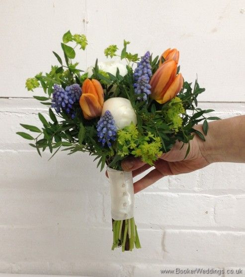 Bridesmaid Bouquet in a Spring Wedding Flower theme in creams, blues and oranges with muscari, tulips, peonies and bupleurum Side View  Wedding Flowers Liverpool, Merseyside, Bridal Florist, Booker Flowers and Gifts, Booker Weddings