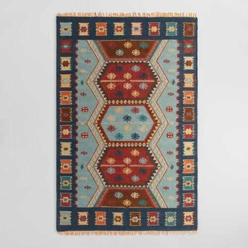 Handmade in India of lustrous wool hand woven with soft cotton, our exclusive floor runner features a timeless design inspired by traditional kilim rugs.