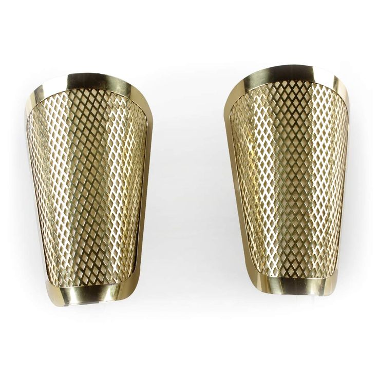 Pair of wall sconces in brass.