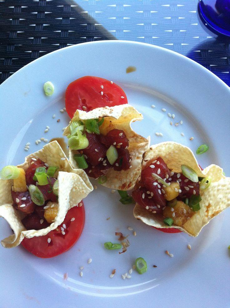 Ahi tuna poke, toasted sesame seeds, pappadum crakers