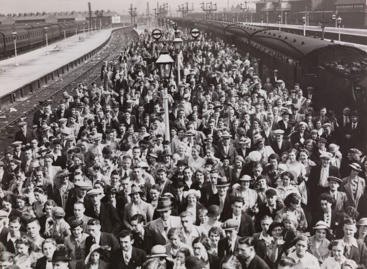 A photograph of Blackpool railway station crowded with holiday visitors just disembarked from the train, taken in September 1937 by Saidman for the Daily Herald.