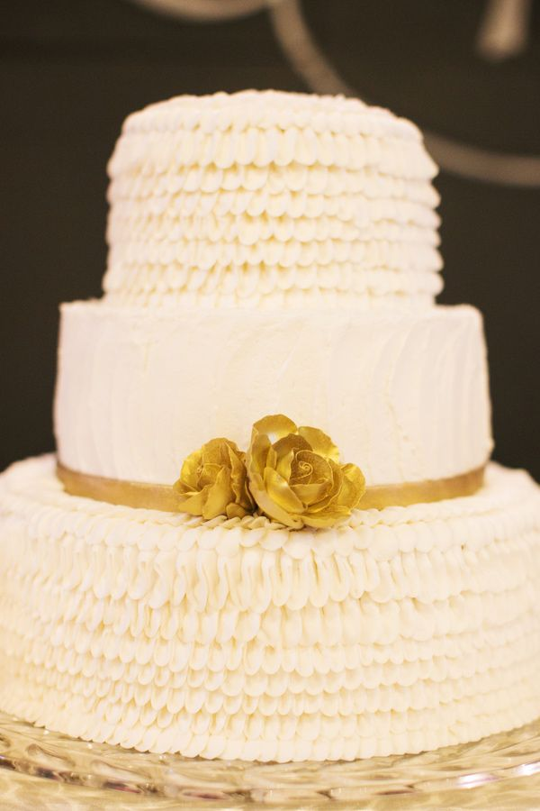 White ruffles and gold roses