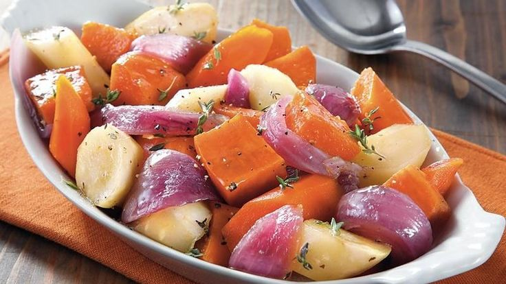 Slow cooked root veggies glazed with honey and olive oil turn into a wonderful side dish.