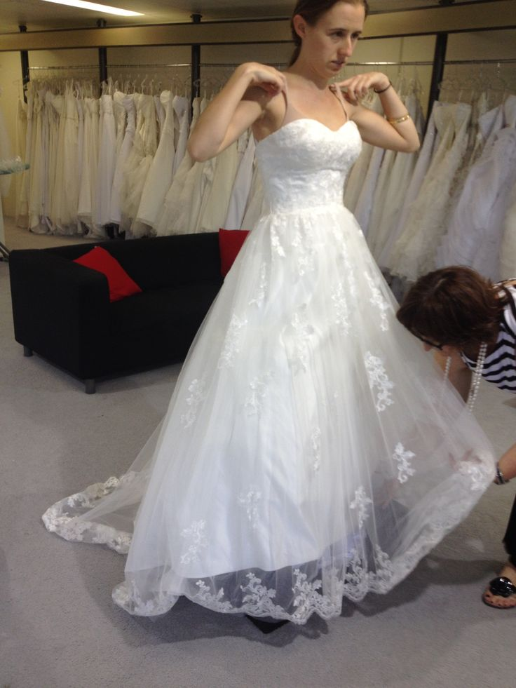 Trying on more wedding dresses