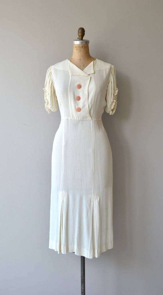 Vintage 1930s white silk crepe dress with fantastic crinkle pleated short sleeves, front button placket concealing snap closures, slightly elevated waist panel constructed skirt and back of neck loop button and keyhole opening. No closures, slips on easily over the head at the front unsnaps. --- M E A S U R E M E N T S ---  fits like: medium bust: 37 waist: 29 hip: 35 sleeve opening: 17 length: 44 brand/maker: n/a condition: excellent  to ensure a good fit, please read the sizing gu...