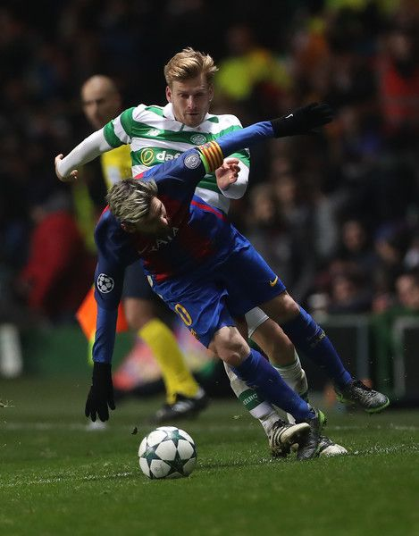 Lionel Messi of Barcelona vies with Stuart Armstrong of Celtic during the UEFA Champions League match between Celtic FC and FC Barcelona at Celtic Park Stadium on November 23, 2016 in Glasgow, Scotland.