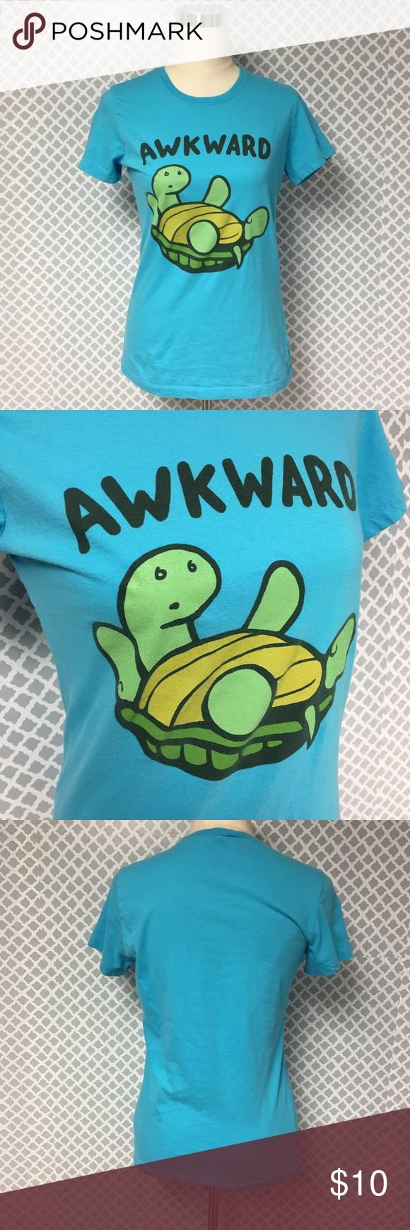 Awkward Turtle Graphic Tee 🔘Description: Super cute awkward T Shirt with turtle stuck on his back. Women's size medium  🔘Condition: Very Good   🔘Material: 100% Cotton               Pit to Pit measures 18 inches and shoulder to hem measures 25.5 inches                 Inventory: C    ⭐️ 15% Off All Bundles! 🛍    💞Thanks for stopping by! 😘 Tops Tees - Short Sleeve