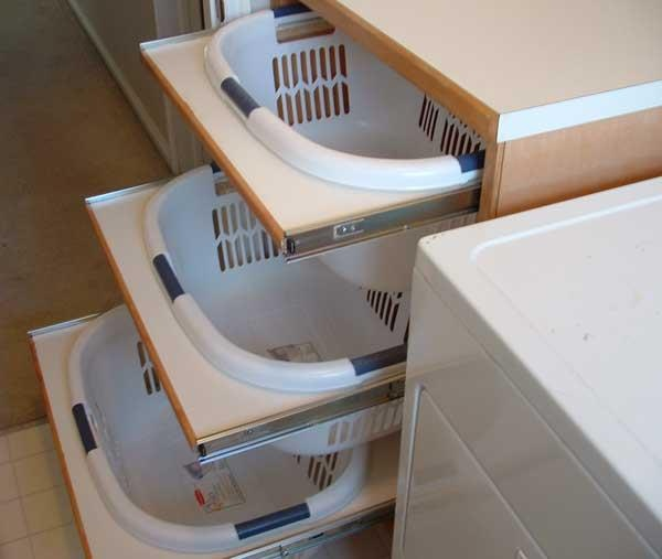 "Pinner said: ""My husband built me shelving to hold 4 baskets for the whites, colour, towels and sorting on top under laundry shoot. under the bench is a shelf that holds 4 baskets, one for each of us. So no more baskets sitting with everyones clothes in, they are all sorted in laundry and everyone puts their own away."""