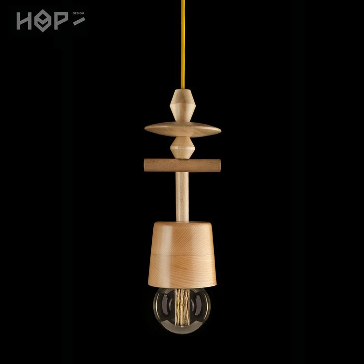 TOTEM lamp by HOP Design more: hop-design.eu/ buy here: http://www.fiufiushop.com/produkt/lampa-woody-totem-6-z-dzwonkiem/ Handmade turned wood lamps made by local craftsmen. Used with edison bulb by Epic Light.