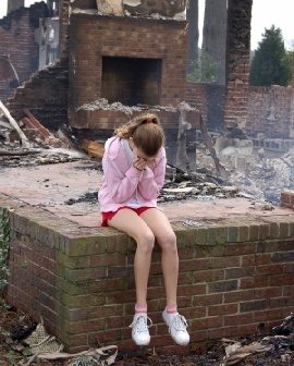 As she sat there surrounded by light smoke and ashes from the fire, she cried. But not tears of sadness... tears of joy. It's finally gone. She can start her life over, get away from her past, and reveal herself instead of hide in fear. This is the end, a new beginning.