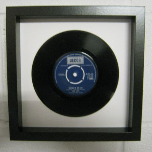 """Up-cycled 7"""" vinyl record, stylishly framed in a new wooden shadow box for maximum enjoyment.  For the greatest choice of musical gifts head over to our dedicated website at; Musicthroughtimegifts.com  For a clear picture the window has been removed to show the overall effect.  Picture frame measures 23cm x 23cm and is 4.5cm deep.  Easy to place on your wall with a purpose built hanger already on the backing plate. We give a 12 month guarantee from date of purchase.  All framed records a..."""
