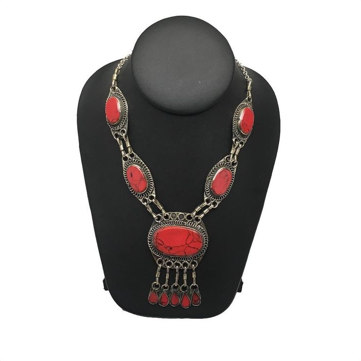 """5 Cabs Afghan Turkmen Oval Red Coral Inlay ATS Statement Long Bib Necklace,TN14. 5 Cabs Afghan Turkmen Oval Red Coral Inlay ATS Statement Long Bib Necklace,TN14            Weight: About 49Grams or so ( Weight of each necklace vary slightly) Length: About 18"""" or so Buyer will receive similar item, which will be picked up randomly from the parcel! Handmade by Afghan Turkmen Craft Mens Afghan craft mens make all these necklaces and other pieces of authentic beautiful jewelries one by one…"""