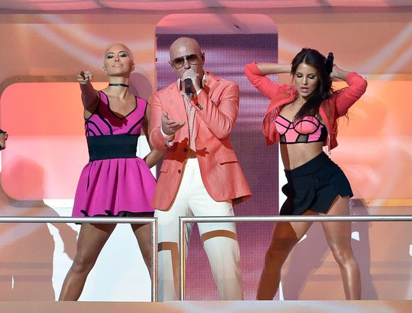 Pitbull Photos - Rapper Pitbull (C) performs with singers Paula Van Oppen (L) and Natasha Slayton (R) of G.R.L. onstage during the 2014 iHeartRadio Music Awards held at The Shrine Auditorium on May 1, 2014 in Los Angeles, California. iHeartRadio Music Awards are being broadcast live on NBC. - iHeartRadio Music Awards Show