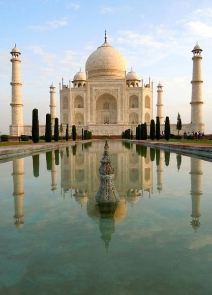 The Taj Mahal was a building made by an old emporer, Mumtaz Mahal, in memory of his third wife. this building is so beautiful.