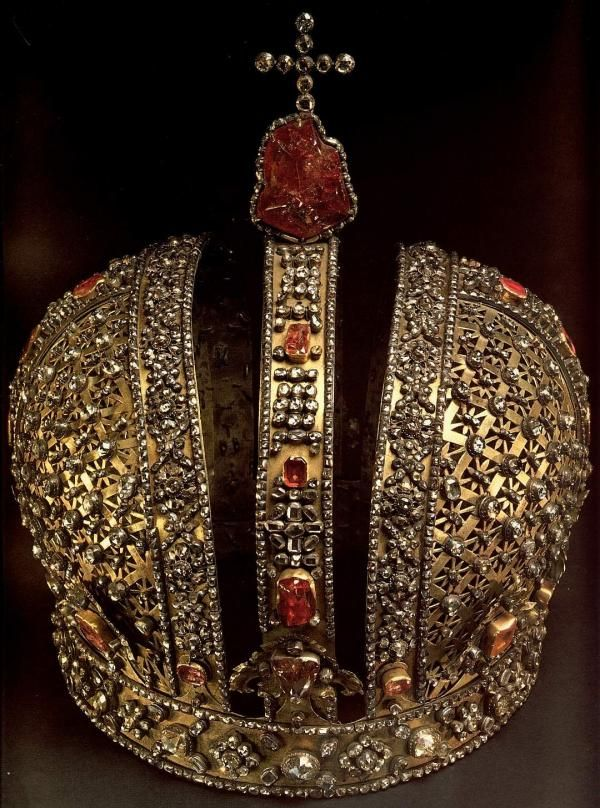 Crown of the Russian empress Anna Ioanovna - precious headdress made in St. Petersburg in 1730-1731, supposedly by Gotlib Vilghelm Dankel. Over two and a half thousand of especially selected diamonds, rubies and tourmalines have been encrusted into the silver base of the crown. The majority of the stones have decorated the crown of the empress Katherine I before, as well as the irregular-shaped dark-red tourmaline placed under the diamond cross. It was bought in 1676 from Chinese Bogdukhan…