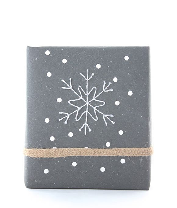 DIY Gift Wrap Idea #8: Baker's Twine Snowflake This awe­some tuto­r­ial shows you how to shape an elab­o­rate snowflake design with pins and baker's twine. Sprin­kle the pack­age with a few cutout dots and you're set with one beau­ti­ful bundle.