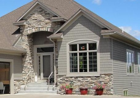 Air stone in the front of the house home improvement Vinyl siding that looks like stone