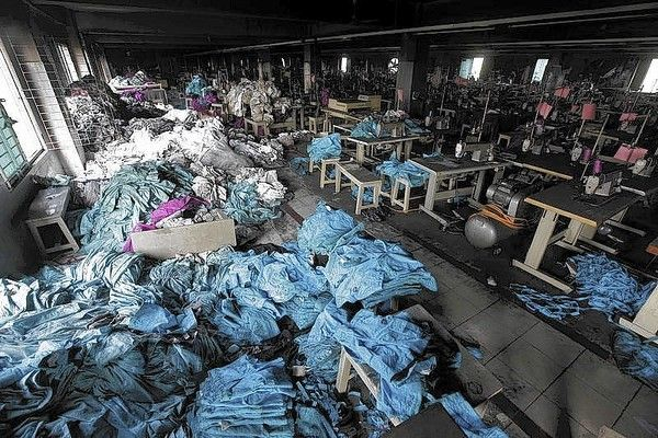 Chloe Burgin 5.02.14. Clothes and sewing machines are seen in the Tazreen Fashions garment factory, where 112 workers died in a fire, in Savar. The fire sparked protests from thousands of workers who claimed the building had been unsafe to work in; Delwar Hossain denied the allegations.