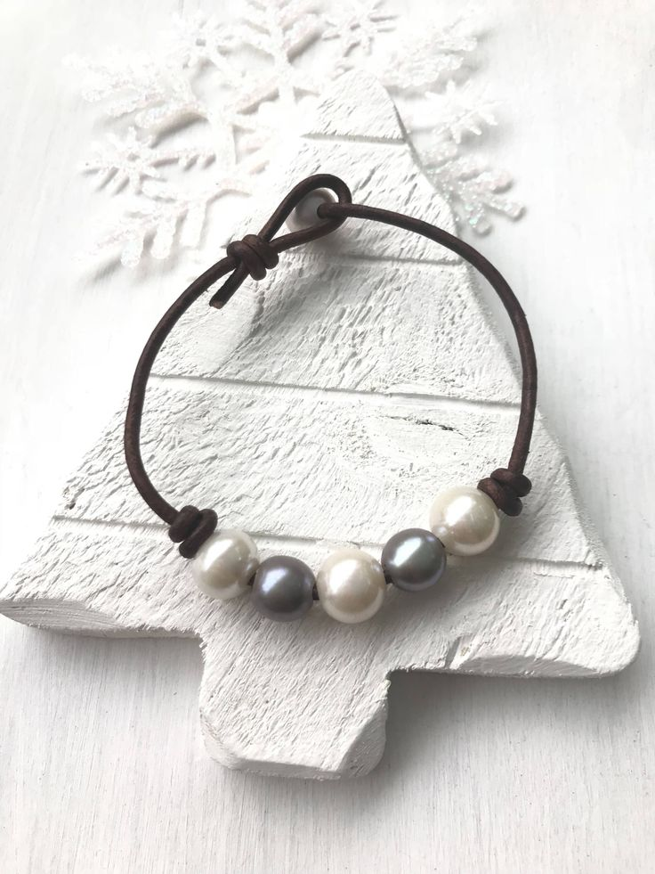 A personal favorite from my Etsy shop https://www.etsy.com/listing/553736833/leather-pearl-bracelet-pearl-bracelet