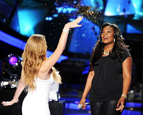Judge Mariah Carey and contestant Candice Glover onstage at FOX's 'American Idol' Season 12 Top 6 Live Performance Show on April 10, 2013 in Hollywood, California.