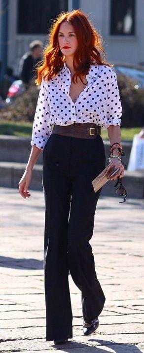 Black pants, black and white polka dot shirt, brown broad belt and brown shoes